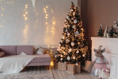 Winter home decor. Christmas tree in loft interior. Old vintage furniture