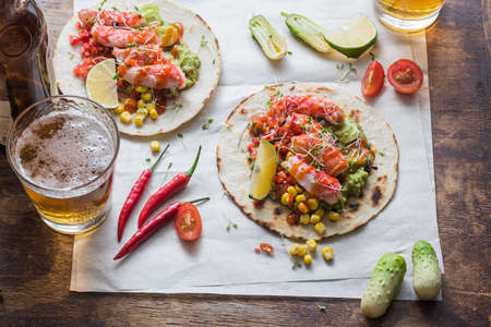 Crab tacos with guacamole, corn and salsa, flat lay