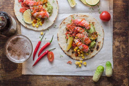 Mexican tacos with crab meat, avocado, corn and salsa