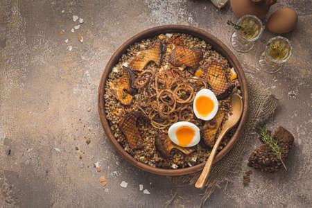 Vegeterian Buckwheat pilaf with mushrooms, onion and eggs