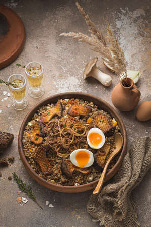 Buckwheat pilaf with mushrooms, onion and eggs.