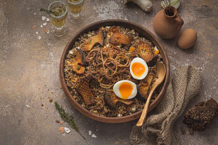Healthy buckweat porridge with mushrooms and eggs Stock Photo