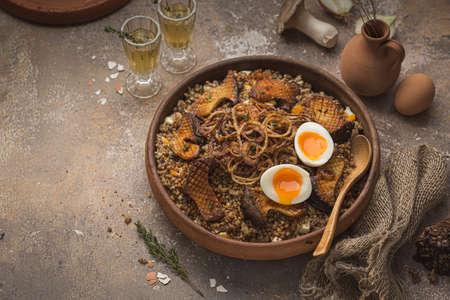 Vegeterian Buckwheat porridge with mushrooms, onion and eggs