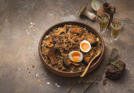 Buckwheat pilaf with mushrooms, onion and eggs