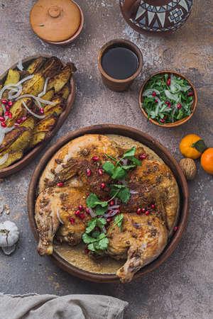 georgian cuisine - chkmeruli, grilled chicken with cream and garlic sauce Stock Photo