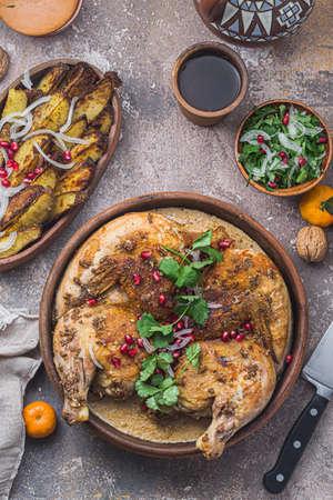 georgian cuisine - chkmeruli, grilled chicken with cream and garlic sauce. Stock Photo