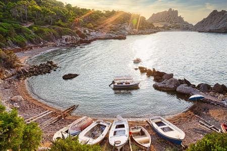 Small speed boats in wild bay of Mediterranean sea, Greece Foto de archivo