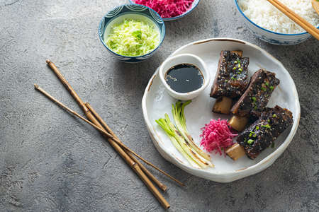 Smoked sticky beef short ribs with radish and rice, copy space