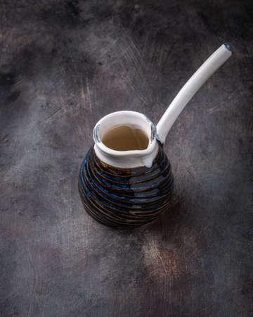 Ceramic Turk to brew coffee on dark Banque d'images