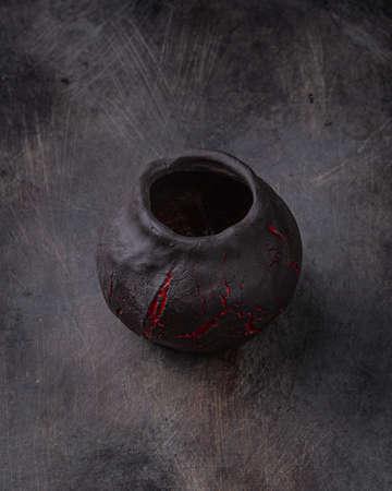 Handmade ceramic cup on dark