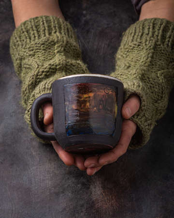 Hand made cup in female hands