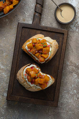 Italian Appetizer Bruschetta with roasted Pumpkin, Red Bell Pepper, Spinach, Garlic and Feta Cheese Banque d'images