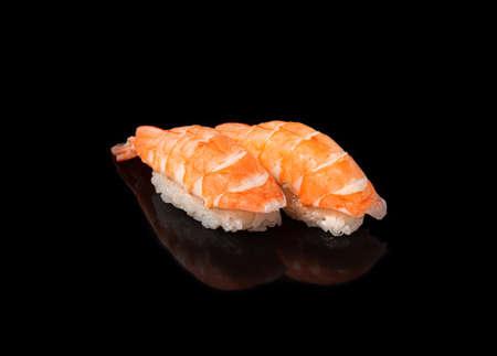Japanese seafood sushi nigiri with shrimp, on black background Banque d'images