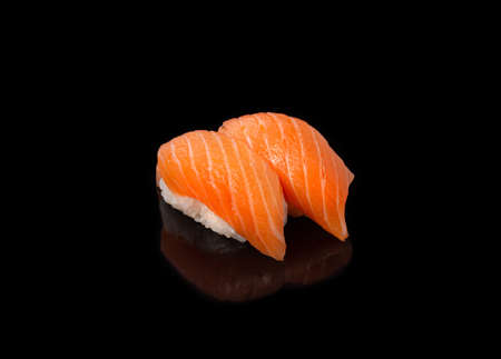Japanese seafood sushi nigiri with salmon, on black background