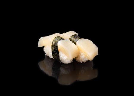 Japanese seafood sushi nigiri withscallops, on black background