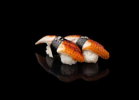 Japanese seafood sushi nigiri with unagi, on black background
