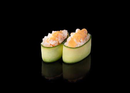 Gunkan maki sushi with shrimps, black background
