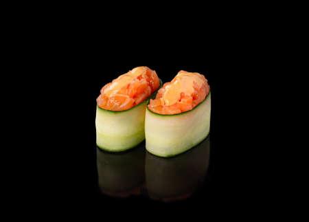 Gunkan maki sushi with salmon, black background