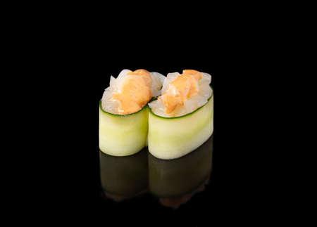 Gunkan maki sushi with scallops, black background