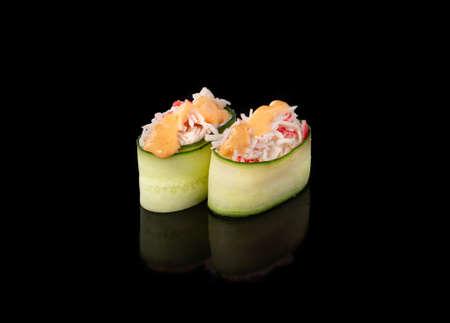 Gunkan maki sushi with crab, black background