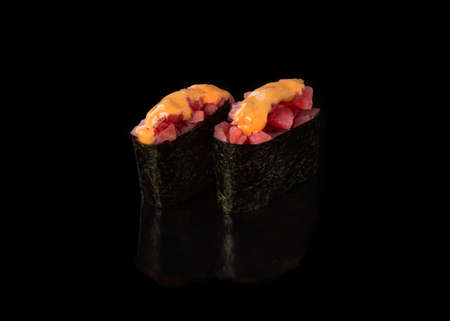 Spicy Gunkan maki sushi with tuna, black background