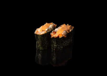 Spicy Gunkan maki sushi with unagi, black background