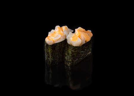 Spicy Gunkan maki sushi with scallops, black background