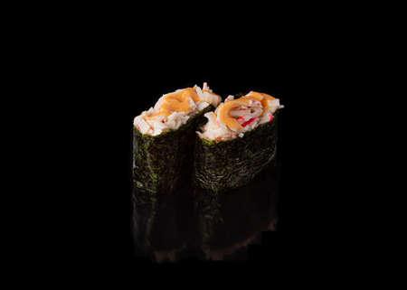 Spicy Gunkan maki sushi with crab meat, black background