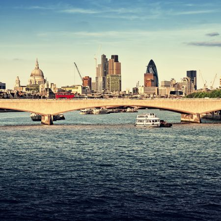 City of London in late afternoon light. This view includes: St. Paul`s Cathedral, The Gherkin, Tower 42, and Waterloo Bridge.  photo