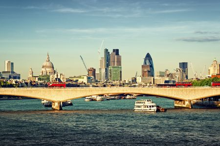 institutions: City of London in late afternoon light. This view includes: St. Paul`s Cathedral, The Gherkin, Tower 42, and Waterloo Bridge.