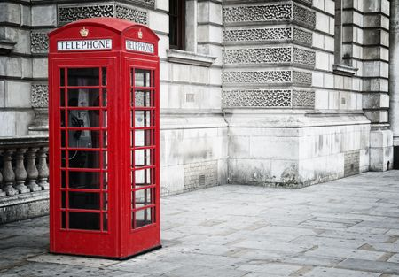 Traditional old style UK red phone box in London. photo