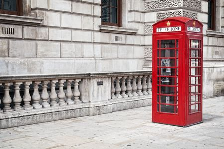 london street: Traditional old style UK red phone box in London.