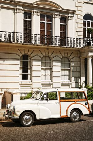Elegant apartment building and an old car at  Notting Hill, London. photo