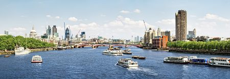 City of London view from Waterloo Bridge. This view includes: St. Paul`s Cathedral, The Gherkin, Tower 42, and Blackfriars Bridge.  photo