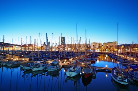 marina water: Night view of  Port Vell in Barcelona - Spain