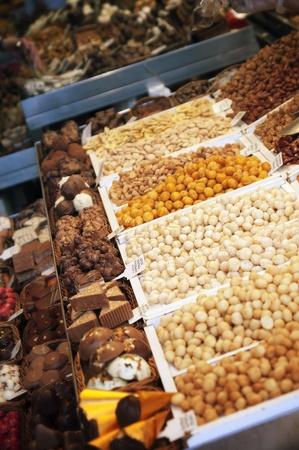 boqueria: Stall with chocolates candy at Boqueria Market in Barcelona. Stock Photo