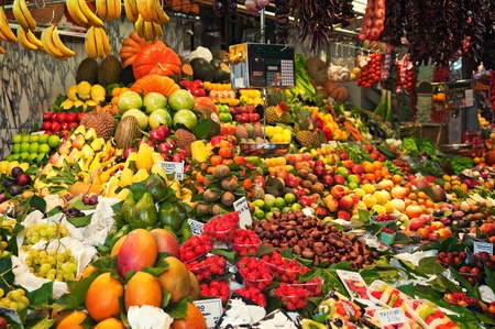 farmer's market  market: Colourful fruit and vegetable market stall in Boqueria market in Barcelona.