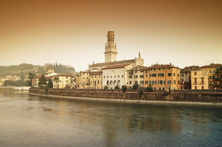 visible: View of  Adige River and riverside apartments. Verona Cathedral and Castel San Pietro are also visible. Stock Photo