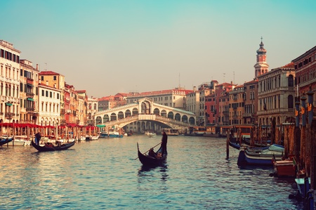 Rialto Bridge and gondolas  in Venice.