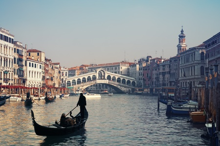 Rialto Bridge and gondolas  in Venice. photo