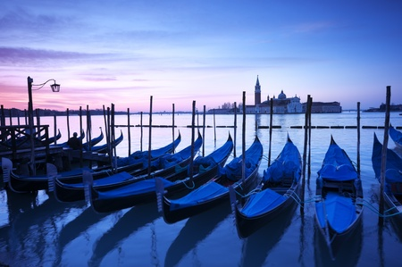 San Giorgio Maggiore church and gondolas at dawn in Venice