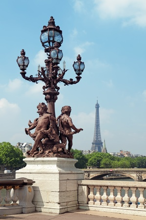 champs elysees quarter: Decorative street lamp on Pont Alexandre Bridge with the Eiffel Tower in the background  Stock Photo
