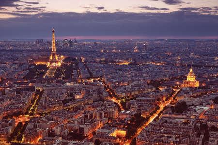 Paris, France - Jun 22, 2012 Night view of Paris with Eiffel Tower and St  Pierre de Montmartre