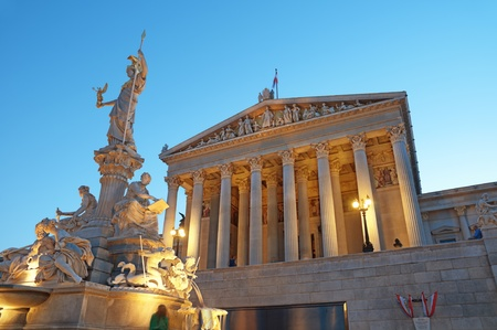 Austrian Parliament Building and The Athena Fountain (Pallas-Athene-Brunnen) at night. Stock Photo - 16232820