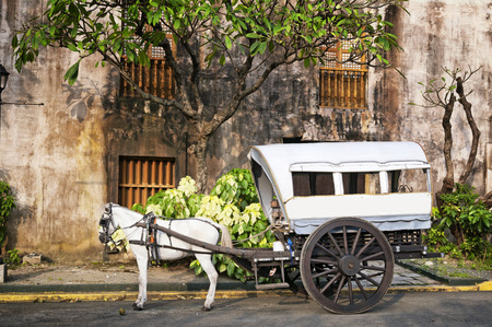 manila: Horse Drawn Calesas waiting for tourists  in Intramuros, a historical part of Manila