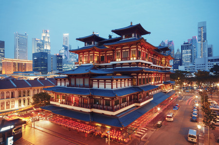 Buddha Toothe Relic Temple in Chinatown with Singapore s business district in the background  photo