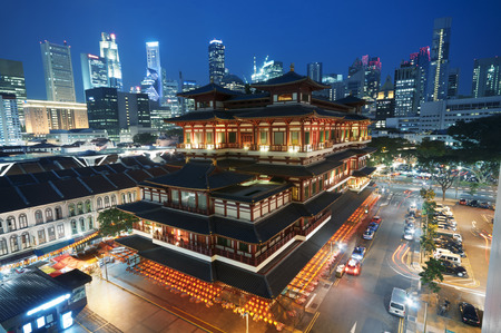 chinatown: Buddha Toothe Relic Temple in Chinatown with Singapore s business district in the background