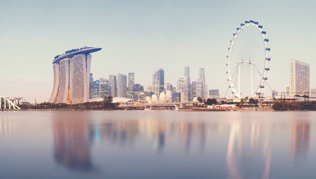 Panoramic image of Singapore s skyline at sunrise   stiched from several images  Panoramic