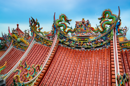 chinese temple: Decoration on the rooftop of a Bishan Temple in Taipei   Stock Photo