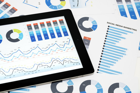 Business charts and diagrams on digital tablet. photo